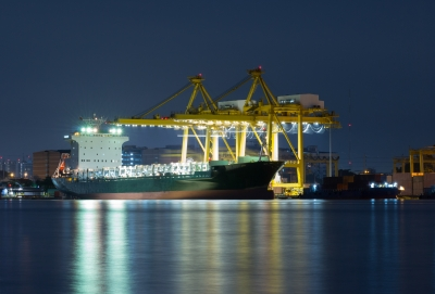 Container Cargo Freight Ship With Working Crane Bridge In Shipyard Import Export